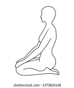 Side view of a woman kneeling down on floor meditating.