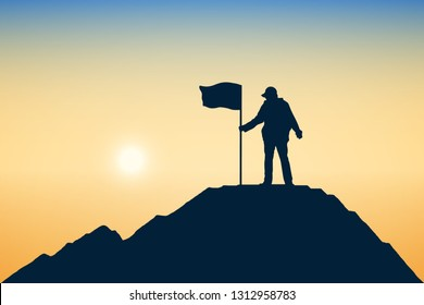 Silhouette of achievement or young man and flag on top mountain, sky and sun light background. Business, success, leadership and goal concept.