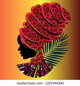 Silhouette of an African woman in a massive headdress. Leopard print.
