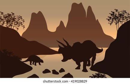 Silhouette of ankylosaurus in river with brown backgrounds