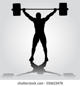 silhouette of athlete is doing snatch exercise. weightlifting