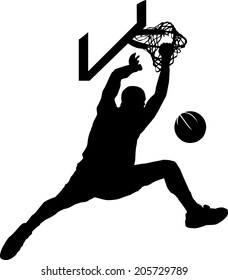 Silhouette of basketball dunk.
