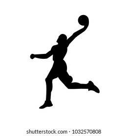 A silhouette of a basketball player in jump