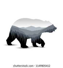 Silhouette of bear with panorama of mountains. Grey tones.