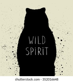 """Silhouette of  bear with """"wild spirit"""" lettering. Vector illustration"""