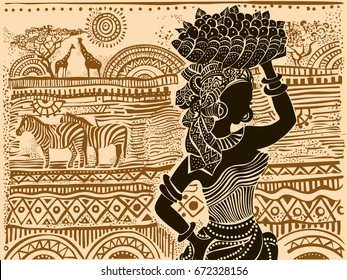 Silhouette of a beautiful African woman against a background of African landscape.