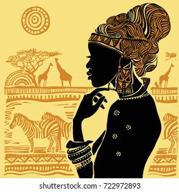 Silhouette of a beautiful African woman against a background of an African landscape.