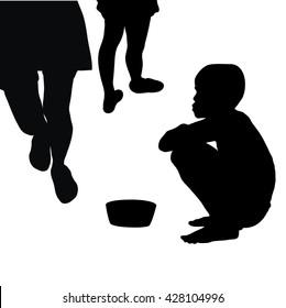 Silhouette of beggar boy begging for money in the street