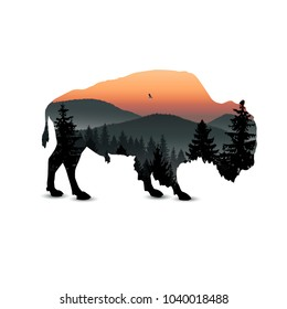 Silhouette of bison with mountain landscape.