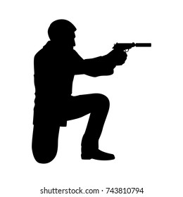 silhouette bodyguard or spy man with gun in hand