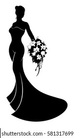 A silhouette bride in her bridal wedding dress holding a wedding bouquet of flowers