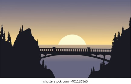 Silhouette of bridge and moon at the night