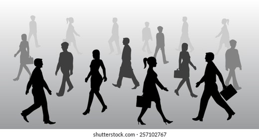 Silhouette of business people walking