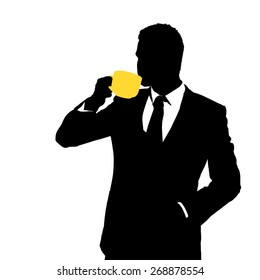 Silhouette of businessman holding a cup of coffee