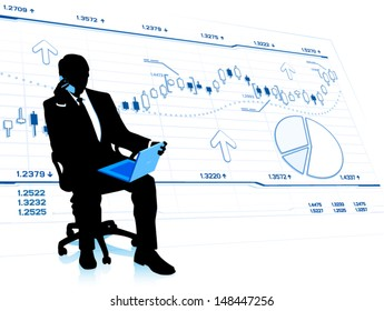 Silhouette of businessman with laptop in office chair