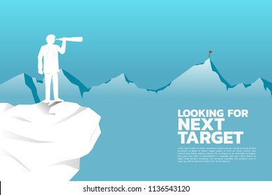 Silhouette of businessman looking through telescope to target on top of far mountain. business concept looking for next target and opportunity.