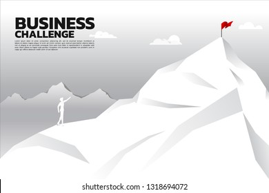silhouette of businessman point to flag at top of mountain. Concept of route to success. Goal Mission Vision success in career path.