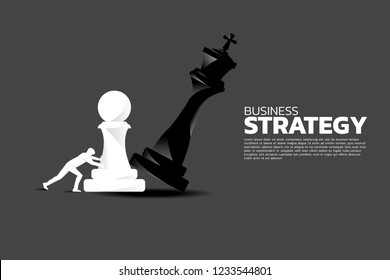 Silhouette of businessman push pawn chess piece to checkmate the king. concept of business strategy and marketing plan disruption