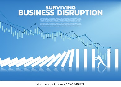 Silhouette of businessman pushing for stop falling of domino. business concept of try to stop the domino effect