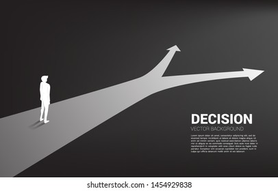 Silhouette of businessman standing at crossroad. Concept of time to make decision in business direction