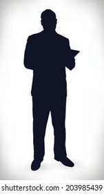 silhouette of businessman with tablet