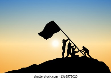 Silhouette of businessmen are setting up a flagpole of victory at the top of the mountain.