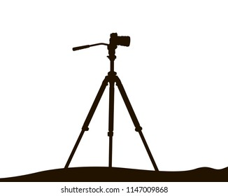 Silhouette of camera on tripod on white