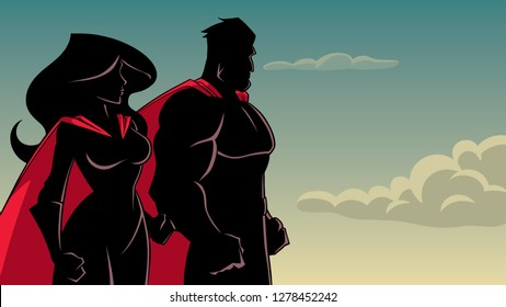 Silhouette cartoon illustration of determined superhero and superheroine, standing side by side and looking in one direction.