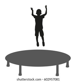 silhouette of a child jumping on a trampoline, having fun