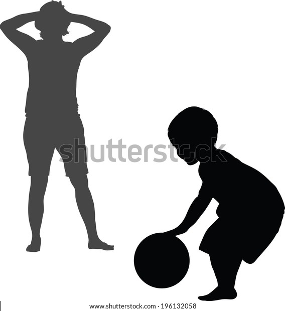 Silhouette of a child playing with a ball with a parent.