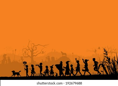 Silhouette of children playing on Halloween night