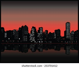 Silhouette of city at sunset