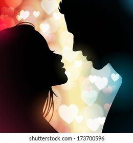 Silhouette of a couple facing each other with hearts in the background