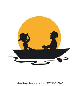 silhouette of couple having a romantic trip on a rowing boat