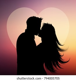 Silhouette of a couple kissing on a heart background