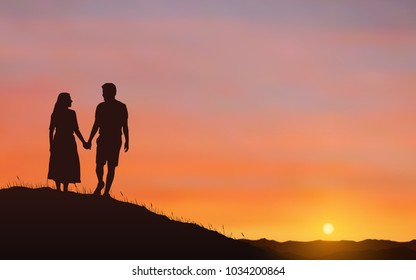 Silhouette couple man and woman holding hand together on hill under sunset sky background