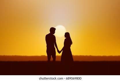 Silhouette couple man and woman holding hand walking together under sunset sky background