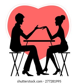 Silhouette of couple in café on the background with red heat