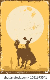 Silhouette of a cowboy riding a wild horse at sunset on a tin sign, vector
