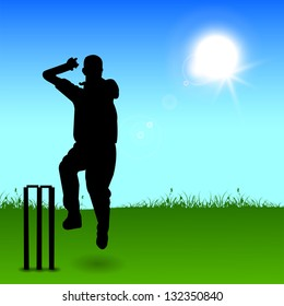 Silhouette of a cricket bowler throwing ball in evening background.