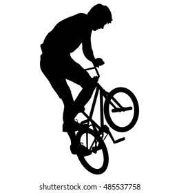 Silhouette of a cyclist male performing acrobatic pirouettes. vector illustration.