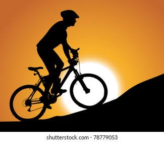 silhouette of a cyclist with sunset background