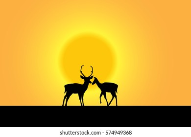 silhouette of deer in love on the sunset.