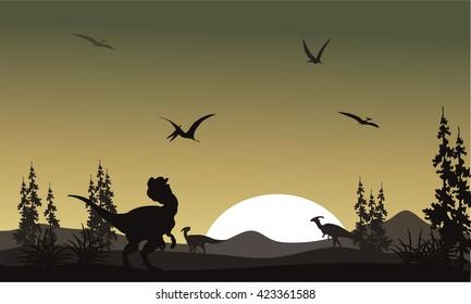 Silhouette of dilophosaurus in park at the sunrise
