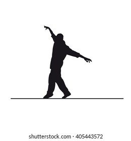 silhouette of a equilibrist, man on little wire