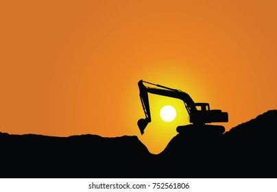 Silhouette of a excavator at sunset