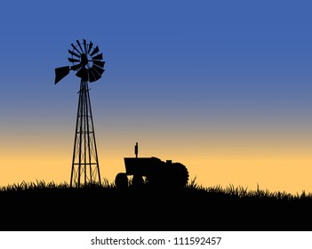 Silhouette of a farm tractor and windmill.