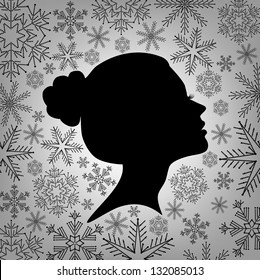 Silhouette of a female head against from snowflakes, vector