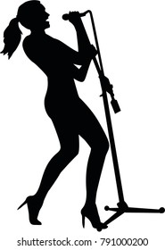Silhouette of a female singer with microphone