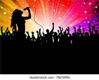 Silhouette of a female singing in front of a large crowd